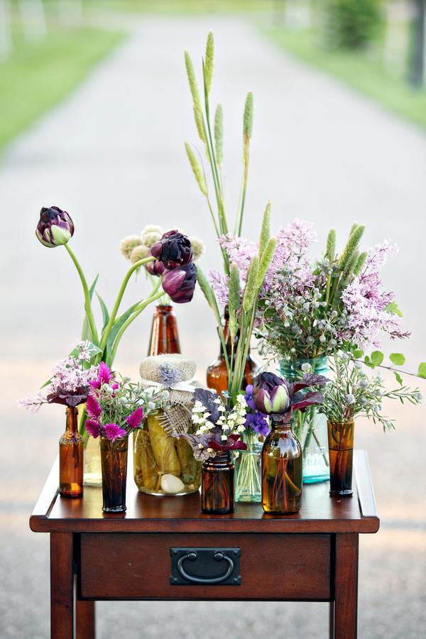 Nice touches, Flowers arranged in lots of different bottles
