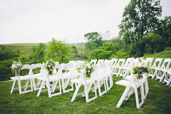 Outdoor Wedding, Lovely flowers and white chairs