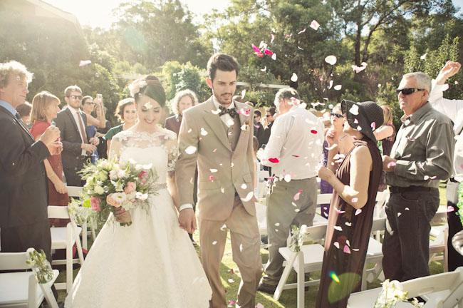 Outdoor Wedding, Petals being thrown as couple walk down the aisle
