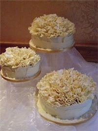 Cakes. A stunning 3 tiered cake covered in Belgian White Chocolate and topped with Belgian White Cho
