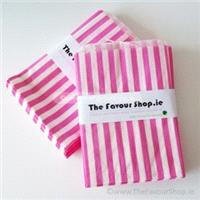 Accessories & Favours. Pack of approx 100 bright pink and white candy striped paper bags measuring 5