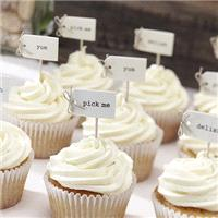 Accessories & Favours. Pack of 12 Cupcake sticks on a textured card with a cute bow and the words de