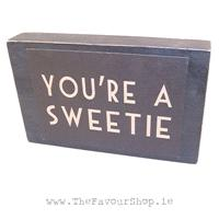 Accessories & Favours. Black distressed effect wooden block. On the front a cardboard sign is attach