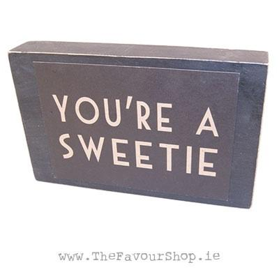 Wedding Accessories, Black distressed effect wooden block. On the front a cardboard sign is attached