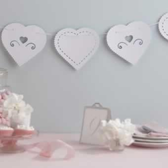 Wedding Accessories, A string of exquisite heart shaped, white card bunting. The hearts alternate be