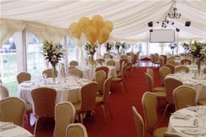 Marquee Weddings, White Marquee with windows, flowing fabric ceiling and a red carpet floor.