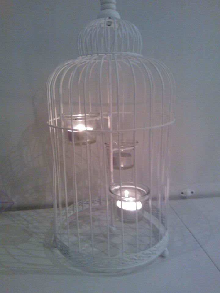 Bird Cages, Plain white bird cage with candles inside.
