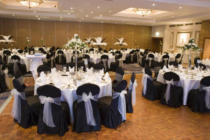 Reception Decor, Black seat covers tied with white ribbon.