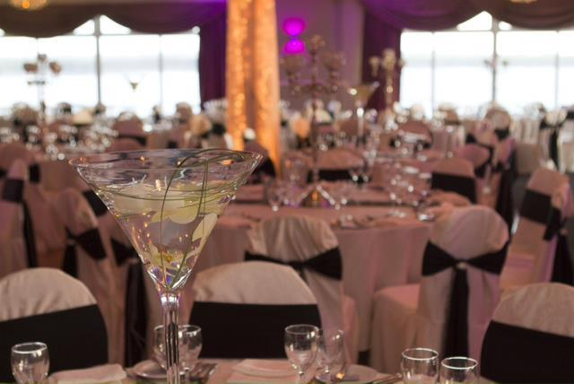 Centerpieces, Martini glass filled with water with floating flowers.
