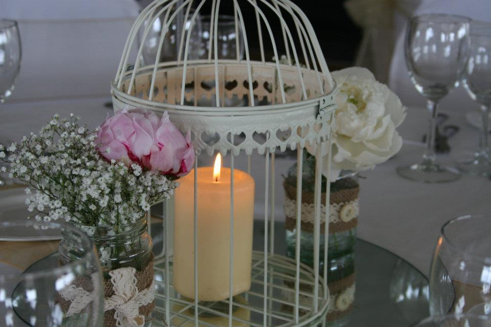 Centerpieces, A large white birdcage containing a single candle.
