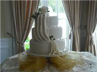 Cakes. Wedding Cake with Cloth, Ribbon & Flowers. All cakes are handcrafted by an award winning cake