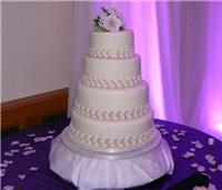 Cakes. Four Tier Wedding Cake with Bead Design. All cakes are handcrafted by an award winning cake d