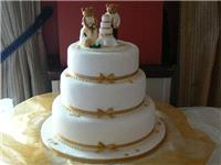 "Cakes. ""Cutting The Cake"" Wedding Cake (Three Tier including topper). All cakes are handcrafted by a"