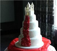 Cakes. Cascade Wedding Cake with Flowing Hearts and Sugar Castle (Four Tier inc Castle). All cakes a