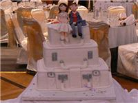 Cakes. Suitcase Wedding Cake with Handmade Bride & Groom. All cakes are handcrafted by an award winn
