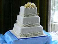 Cakes. Three-Tier Square Cascade Bead Wedding Cake with Lilies (eight different cake flavours availa