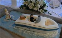 Cakes. Speedboat Novelty Wedding Cake (eight different cake flavours available). All cakes are handc