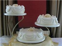 Cakes. Large Three Tier Wedding Cake with Swags & Bows (eight different cake flavours available). Al