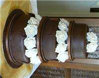 Cakes. Three-Tier Chocolate Wedding Cake with Roses (eight different cake flavours available). All c