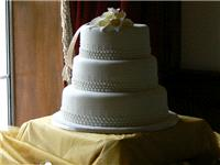 Cakes. Three-Tier Wedding Cake with Bead Piping & Lilies (eight different cake flavours available).