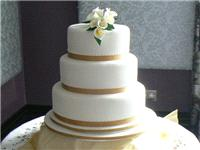 Cakes. Large Three-Tier Cascade Wedding Cake with Lilies (eight different cake flavours available).