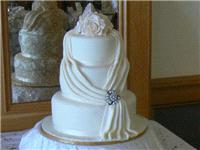 Cakes. Small Three-Tier Cascade Wedding Cake with Double Cloth (eight different cake flavours availa