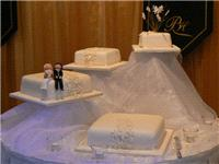 Cakes. Four Tier Snowflake Wedding Cake (eight different cake flavours available). All cakes are han