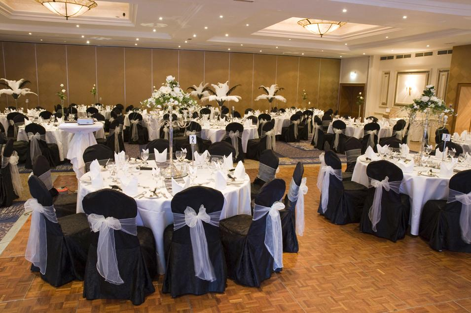 Chair Covers, Black chair covers tied with a white sash.