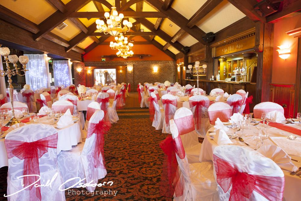 Chair Covers, White chair covers tied with a dark pink sash.