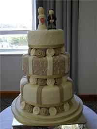 Cakes. Coffee and Cream Wedding Cake. Each wedding cake is decorated to your own specification and c