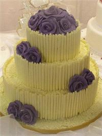 Cakes. White Chocolate Curls Wedding Cake. Each wedding cake is decorated to your own specification