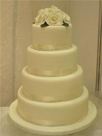 Cakes. Diamante and Roses Wedding Cake. Each wedding cake is decorated to your own specification and