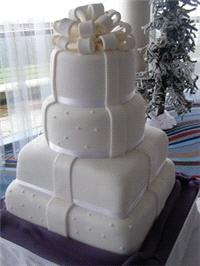 Cakes. Parcels Wedding Cake. Each wedding cake is decorated to your own specification and colour the
