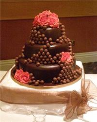 Cakes. Malteser Delight Wedding Cake. Each wedding cake is decorated to your own specification and c