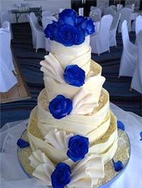 Cakes. Blue Rose Wedding Cake. Each wedding cake is decorated to your own specification and colour t