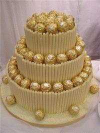 Cakes. Ferrero and White Chocolate Wedding Cake. Each wedding cake is decorated to your own specific