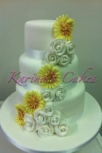 Cakes. Yellow Flower Wedding Cake. Each wedding cake is decorated to your own specification and colo