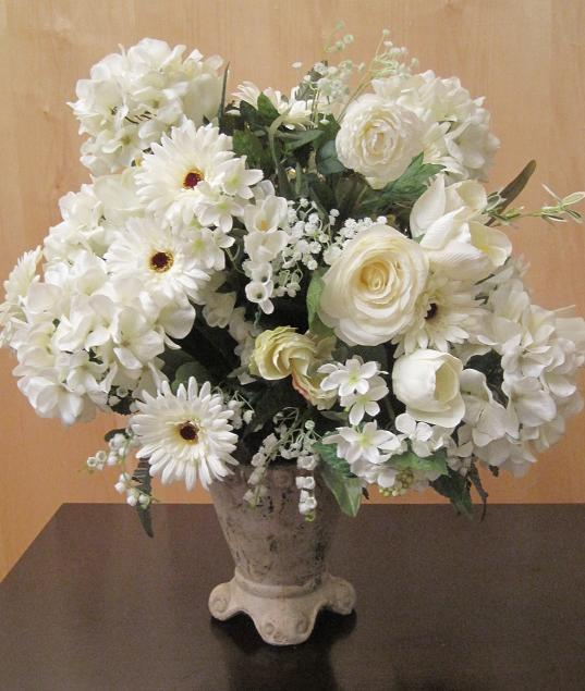 Flowers, Stone urn filled with an ivory and white silk floral arrangement.