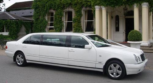Chauffeurs, White Mercedes Stretched Limousines. All wedding cars hold SPSV licences issued by the N