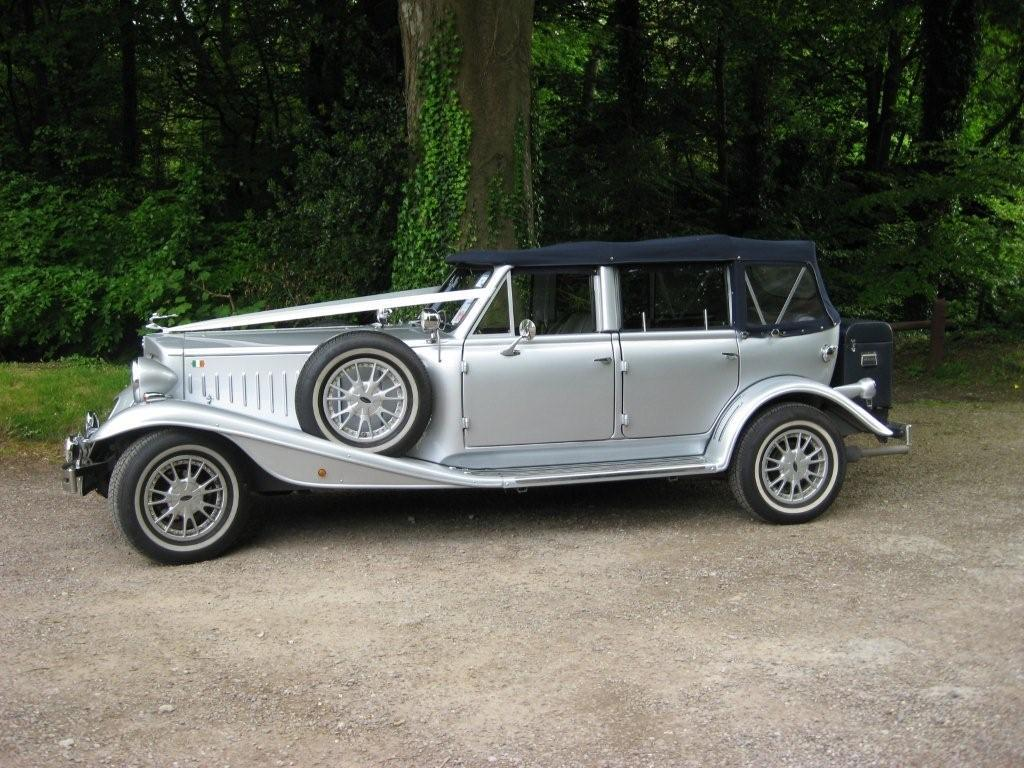 Chauffeurs, Silver Beauford Convertible. Complimentary bottle of champagne with each booking.
