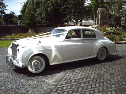 Chauffeurs, 1956 Bentley S1 comes in a stunning white exterior with a grey leather interior together