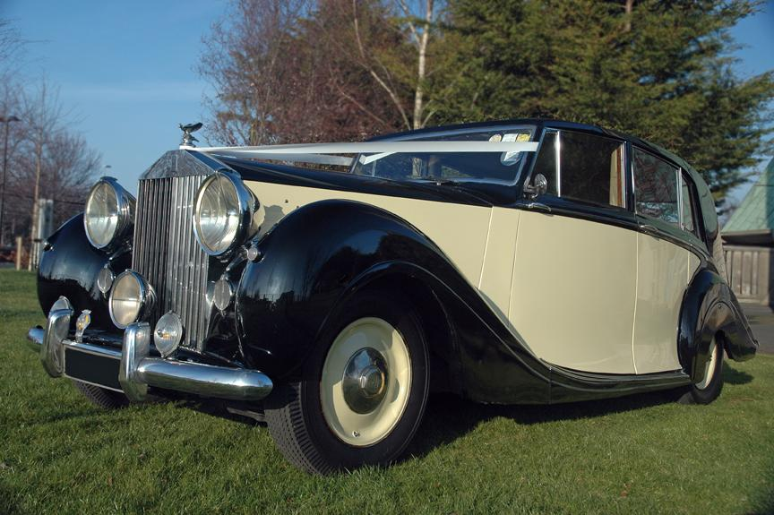 Chauffeurs, 1950 Rolls Royce Silver Wraith. Complimentary bottle of champagne included with every vi