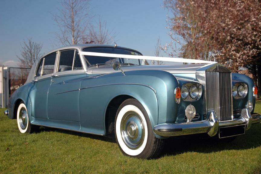 Chauffeurs, 1965 Rolls Royce Silver Cloud III. Complimentary bottle of champagne included with every