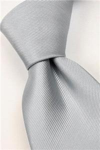 Attire. Mid-grey tie. Connexion ties are hand finished to the highest quality and are 100% silk. Det
