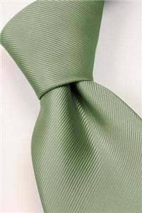 Attire. Green tie. Connexion ties are hand finished to the highest quality and are 100% silk. Detail