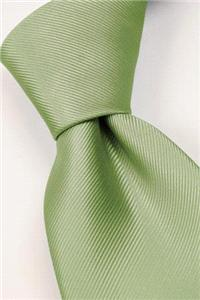 Attire. Light-green tie. Connexion ties are hand finished to the highest quality and are 100% silk.