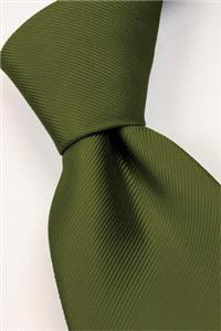 Attire. Dark-green tie. Connexion ties are hand finished to the highest quality and are 100% silk. D