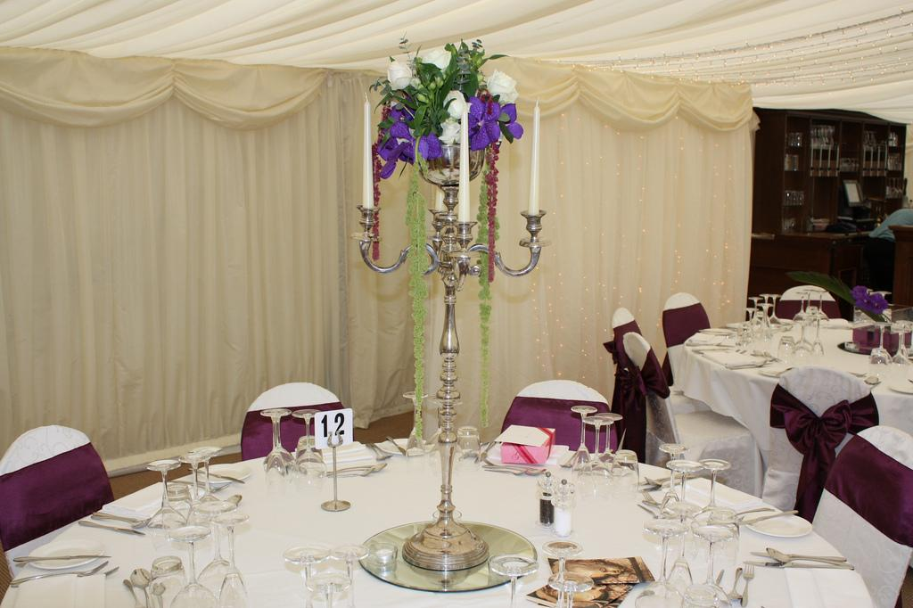 Candelabras, A traditional candelabra with a summertime floral center piece.