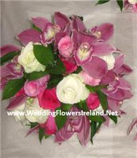 Flowers. Hand-tied rose and orchid arrangement. Wedding packages available.
