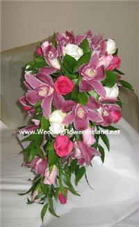 Flowers. _Rose and Orchid Shower_ bouquet. Wedding packages available.